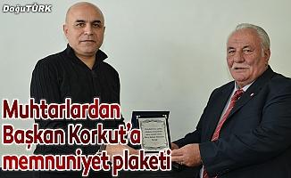 Muhtarlardan Başkan Korkut'a memnuniyet plaketi